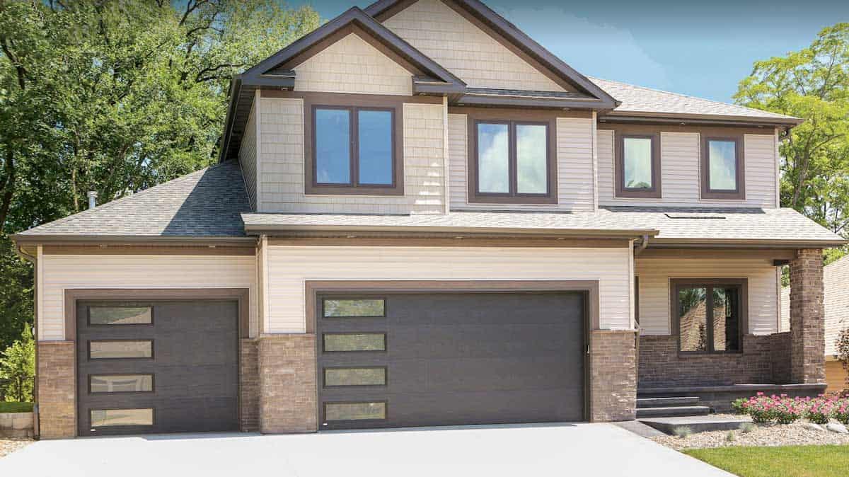 modern garage door with window on large house
