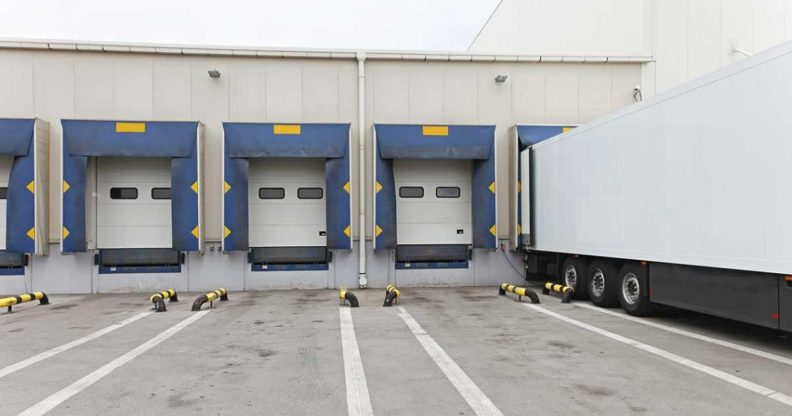 semi backed up to 5 bay loading dock