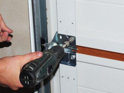 shaky garage door repair person