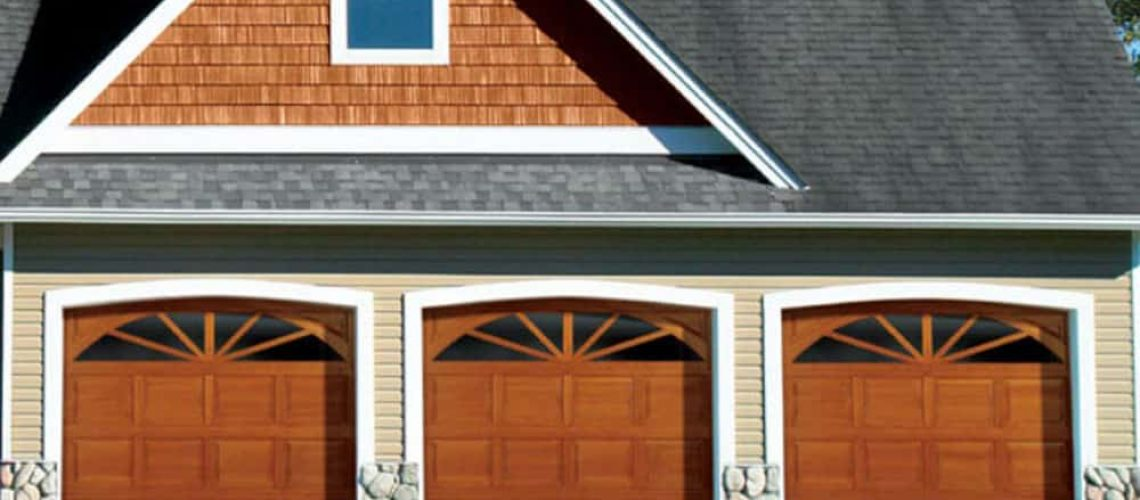 traditional wood overhead garage door on house